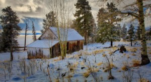 This photograph was taken in the beautiful White mountains of Arizona, just of of HWY. 260 near Greer Arizona. Small barn and home on the left side of the road as you are coming from Honda casino on HWY. 260. just after the Sunrise ski resort turn off.